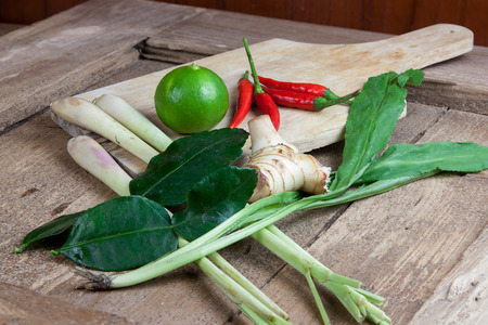 thai pepper: Ingredients for hot and sour Thai soup, Tom Yum Koong. On wood. Stock Photo