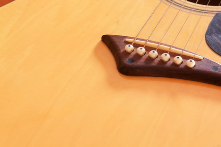 sound of music: bridge acoustic guitars. six strings for background Stock Photo