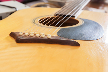 background person: bridge acoustic guitars. six strings for background Stock Photo