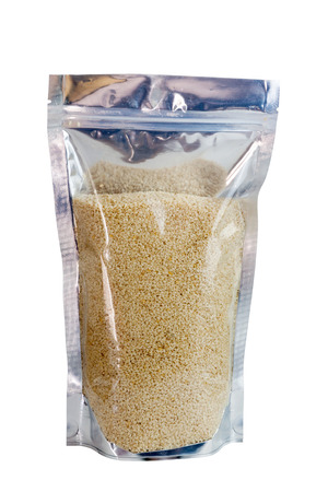 white sesame seeds: White sesame seeds in packaging foil zip lock bag. Isolated on white with clipping paths. Stock Photo
