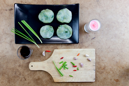 tuberosum: Allium tuberosum. Garlic chives with soy source. Dim sum is chinese cuisine. Dimsum. Flat Lay in Food. Stock Photo