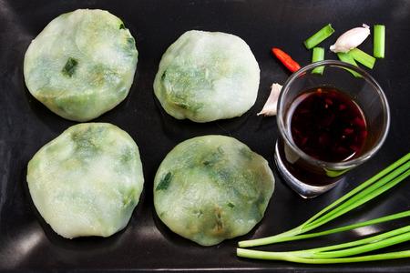 odorum: Allium tuberosum. Garlic chives with soy source. Dim sum is chinese cuisine. Dimsum. Flat Lay in Food. Stock Photo