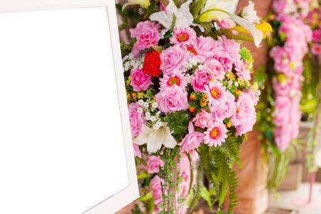 soft   focus: bouquet pink flowers and photo frame white. soft focus