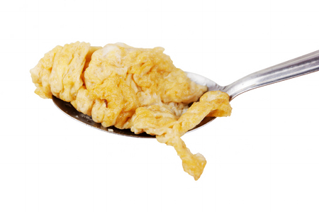 objects with clipping paths: omelet on spoon. isolated on white background. Objects with Clipping Paths