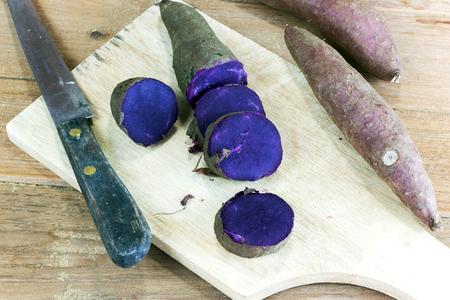 dissect: Steamed purple sweet potato split on wood