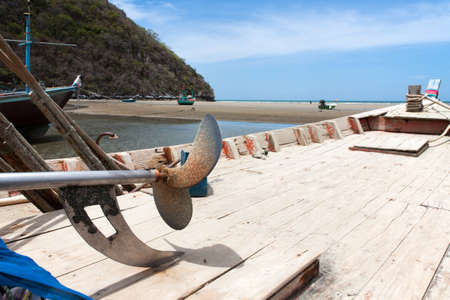 sheltered: Sheltered wood mooring on Beach, On the seaside in Thailand