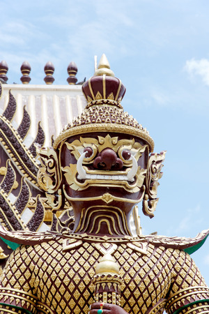 places of worship: Giant Statue in Temple on sky background, Thailand. Art vintage style in Places of worship.