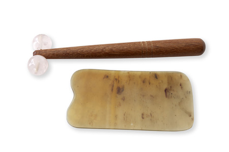 Gua sha Massage Rose Quartz and he yak plate, Chinese medical traditional tool Guasha. Believe Skin Detoxification and more beauty. Isolated on white and objects with clipping paths