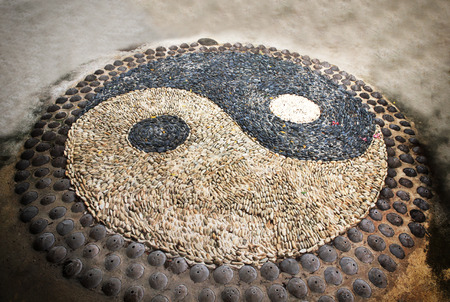 Yin Yang sign. Sort of symbolic stone. Stock Photo