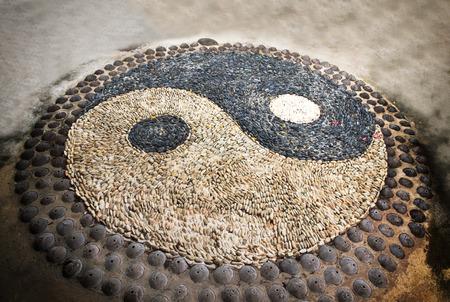 symbolic: Yin Yang sign. Sort of symbolic stone.