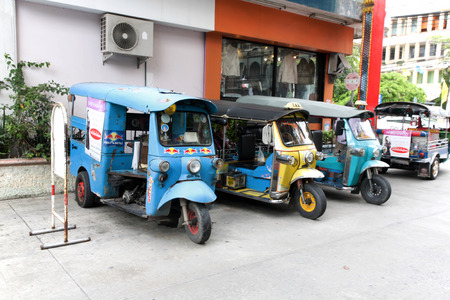 motorized: SUPHAN BURI, THAILAND - JULY10, 2016 : Motorized Tricycle Parking for passengers on the road of Suphan Buri, The Motorized Tricycle are a popular way to transport in Thailand.