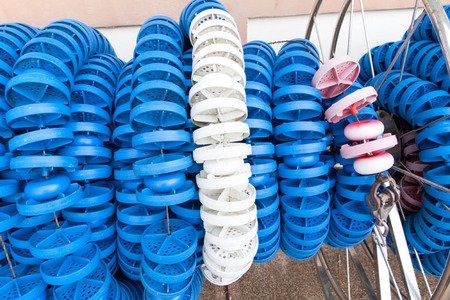 lane lines: Swimming lanes markers in reel storage inside the pool. Pool lane lines for athletics. Stock Photo