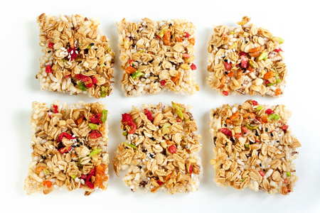 sesame cracker: Crispy rice crust with honey topping on grains. many grains on white background.