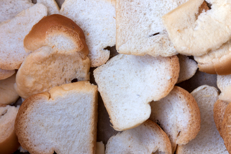 diminutive: Breads petite white or sandwich placed in box paper. closeup. of a pile of mini toasts