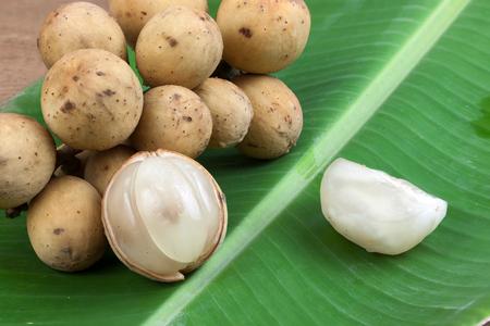 lanzones: Longkong,Langsat or Lanzones fruit on banana leaves.