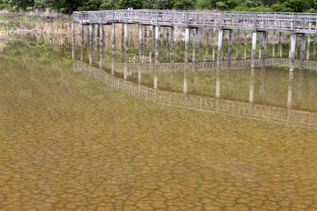 see through: The soil dried had under the flooded and reflection bridge wood. Under water see through of Drought still see traces Stock Photo