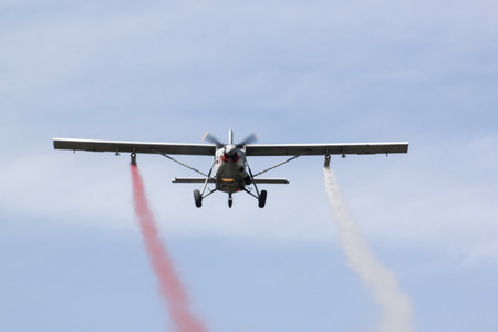 children's show: PRACHUAPKIRIKHAN, THAILAND - JAN 14 2017: Light aircraft Pilatus PC-6 Finally, the masses of the world are stationed of Thai air force flight show on childrens day on January 14, 2017 in Prachuapkirikhan, Thailand.
