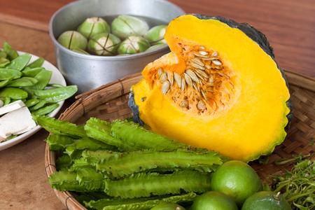 Princess bean (Psophocarpus tetragonolobus) and pumpkin  and vegetable split In bamboo basket for cooking Stock Photo