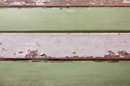 Old wood painted white and green. texture or background.