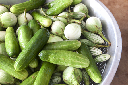 Fresh organic vegetables. Cucumber and eggplant Wash preparation for cooking Stock Photo