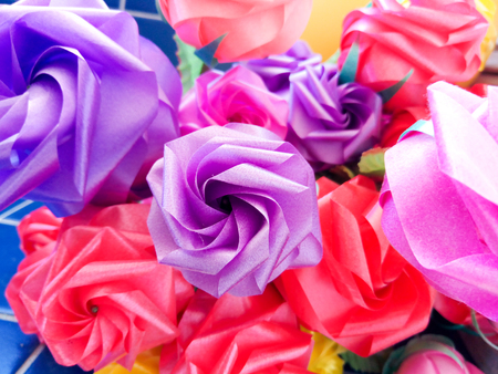 Rose fake flower and Floral backgroundrose flowers made of fabric. The fabric flowers bouquet. Colorful of decoration artificial flower.