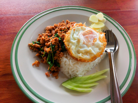 Street food in Thailand. rice with stir-fried of pork and basil leaf with fried egg hot and spicy. Stock Photo