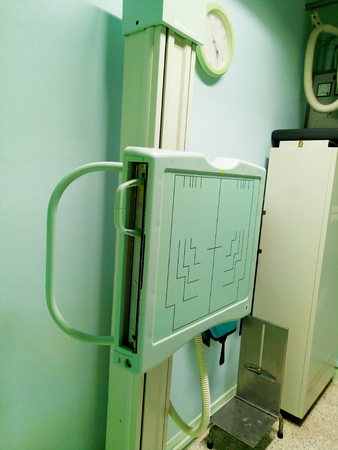X-ray room in a hospital ER operating room with a classic x-ray system. Modern medical equipment, interventional medicine and healthcare concept