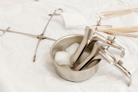 Vaginal Speculum sterilized in alcohol on Medical instruments table. Cervical Screening. Stock Photo