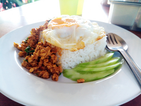 Street food in Thailand. rice with stir-fried of chicken and basil leaf with fried egg hot and spicy.
