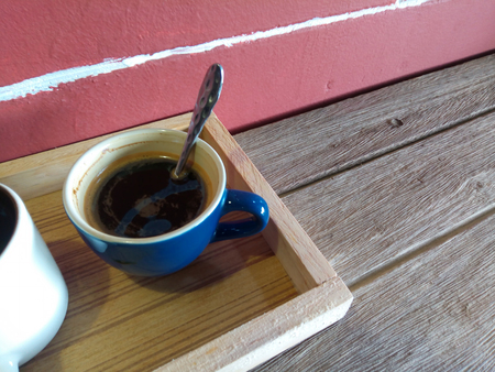 Coffee break business. Cup of espresso coffee on wood table on restaurant coffee house terrace Stock Photo