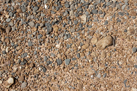 Brown Gravel texture and small stone background. Sand and stones on the floor. The land is covered with stones