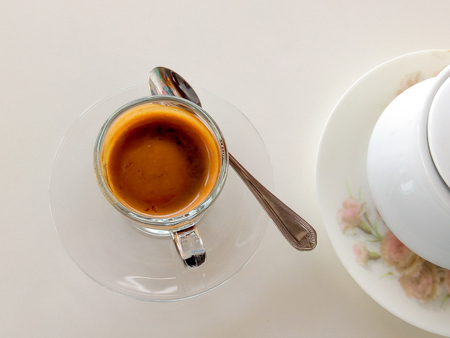 a cup of coffee espresso on white table