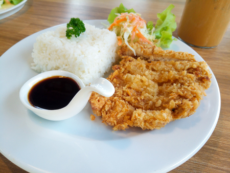 Tonkatsu rice and Fried pork japanes food in white dish