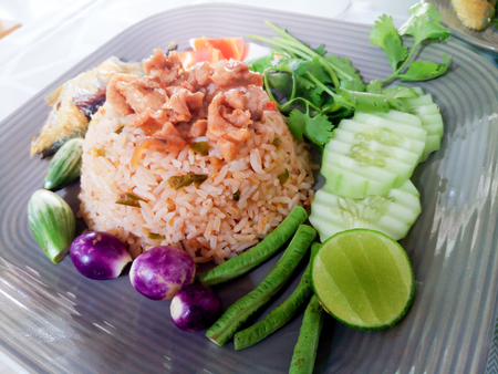 Thai food cuisine named Nam Prik Long Ruea or fried rice with shrimp paste sauce dry shrimp salted egg and mixed vegetable. And fried mackerel.