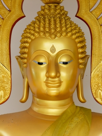 Face Golden buddha statue in Hatyai, Thailand photo