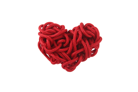 coiled rope: Red Heart shape isolation from the rope is coiled on white background
