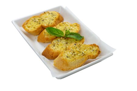 Garlic breads 4 pieces and Mint leaves on white paper on the square white plate isolate on white background, top front view, selective focus at the first front pieces. Stock Photo