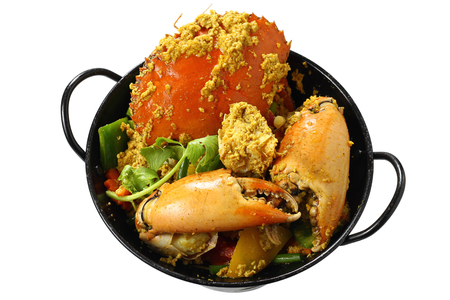 Stir-fried Giant Mud-Crab (Mangrove-Crab or Black-Crab) with Yellow Curry Powder on Black Pan, Isolated on White Background with Clipping Path, High Angle Top View, Selective Focus at Food.