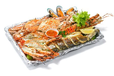 Grilled Mixed Seafoods platter Set contain Lobsters Fish Blue Clabs Big Shrimps Mussels Clams Calamari Squids with pieces of lemon & vegetables isolated on white background, High Angle Top side view. Stock fotó