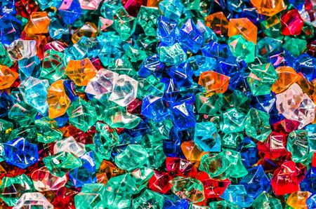 Colorful plastic crystals and colorful of background photo