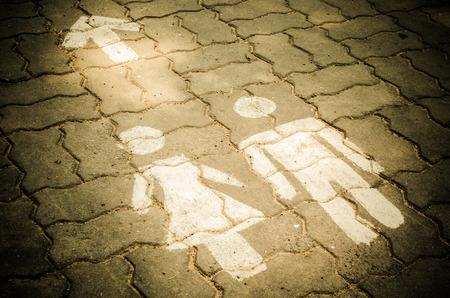 Sign of public toilets WC on the floor. outdoor (toilet, floor, signs)