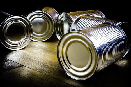 steel plant: Aluminum cans on wooden background (caned, aluminum, recycle) Stock Photo