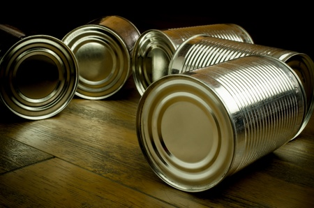 tin cans: Tin cans on wooden background cans tin product Stock Photo