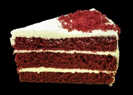 porcion de torta: Pastel de terciopelo rojo sobre fondo negro. aislado Foto de archivo