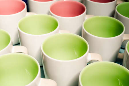 two tone: Many two tone color coffee cups, above view
