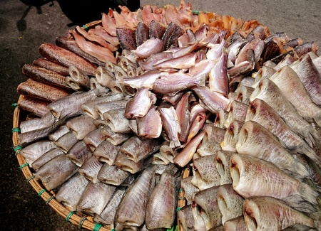 expose: Dried fish sale on fish market  Dried fish and garlic expose to sun Stock Photo