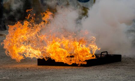 fire fighter: Close up of extinguishes a fire, fire extinguisher on a training fire Stock Photo