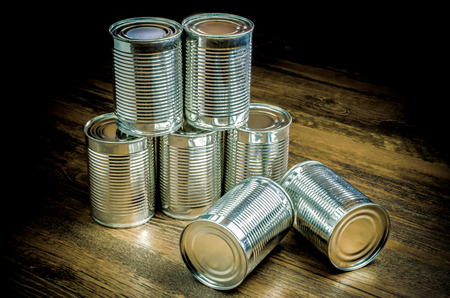 tin cans: Tin cans for food on wooden background