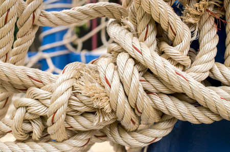 fixed line: Rope And Knot On Background. Outdoor view, Selective focus and Close up detail image