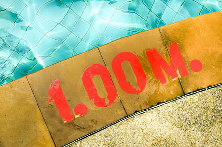 private parts: Swimming pool with Number 1.00 on ground at hotel Stock Photo